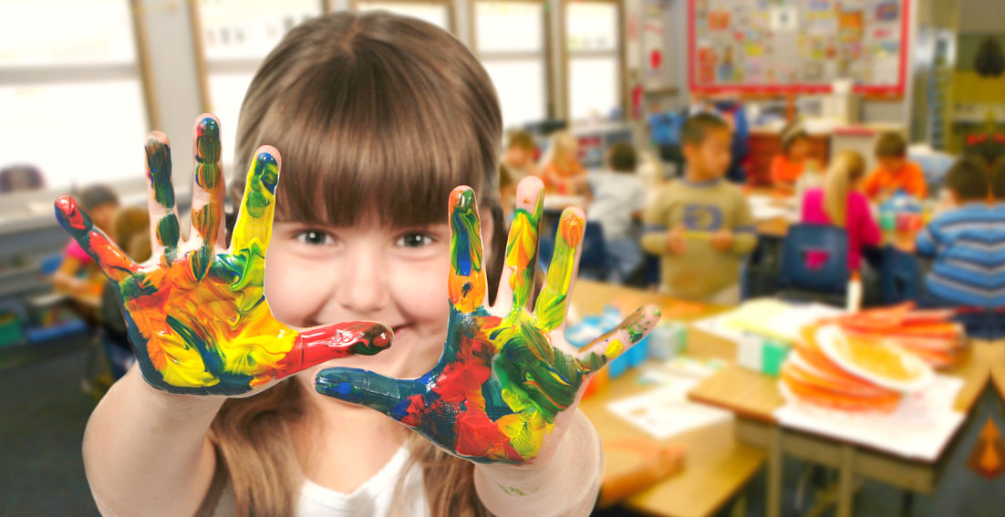 girl with hands full of colors